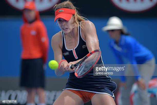 France's Alize Cornet plays a shot during her women's singles match against China's Zhang Shuai on day two of the 2015 Australian Open tennis...
