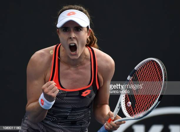 TOPSHOT France's Alize Cornet reacts after a point against Spain's Lara ArruabarrenaVecino during their first round women's singles match on day two...