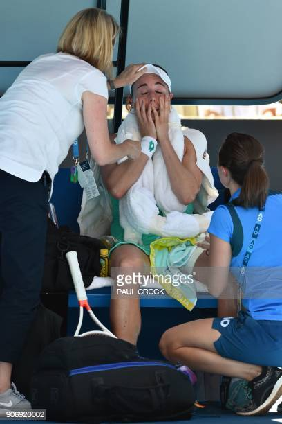 France's Alize Cornet reacts in receiving treatment on the bench while playing against Belgium's Elise Mertens during their women's singles third...