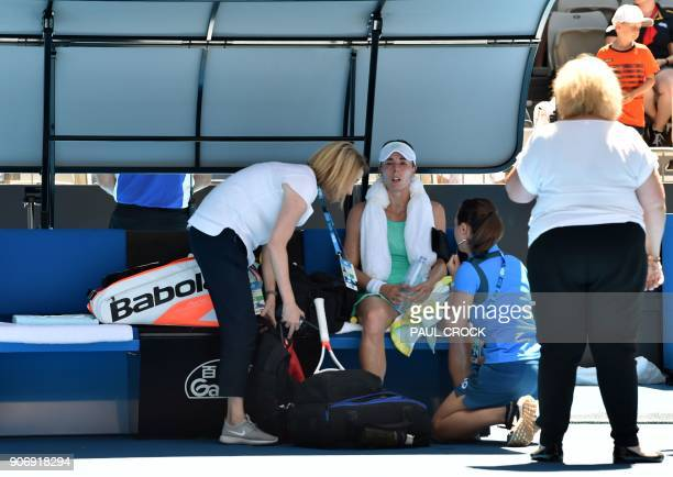 France's Alize Cornet reacts on the bench while playing against Belgium's Elise Mertens during their women's singles third round match on day five of...