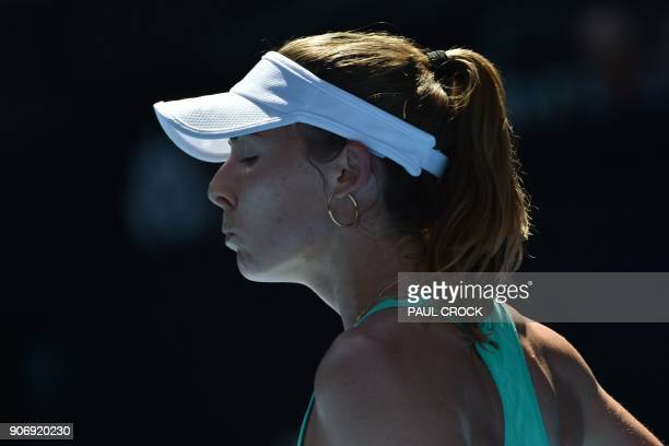 France's Alize Cornet reacts while playing against Belgium's Elise Mertens during their women's singles third round match on day five of the...