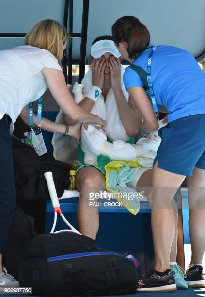 France's Alize Cornet receives medical attention during their women's singles third round match against Belgium's Elise Mertens on day five of the...
