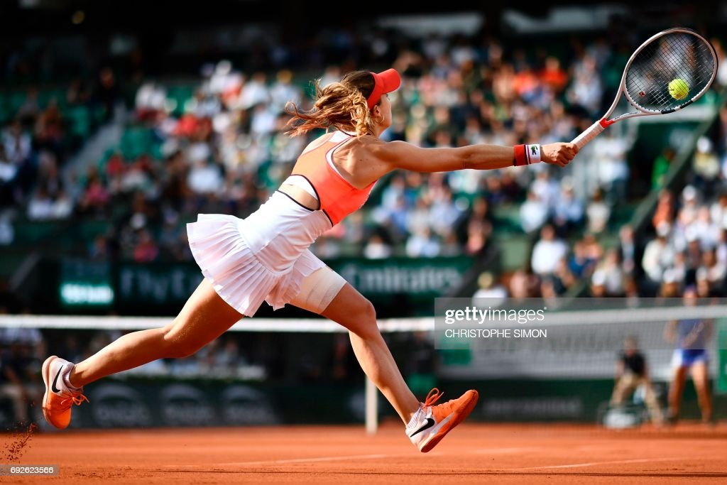 France's Alize Cornet returns the ball to France's Caroline Garcia during their tennis match at the Roland Garros 2017 French Open on June 5, 2017 in Paris. /