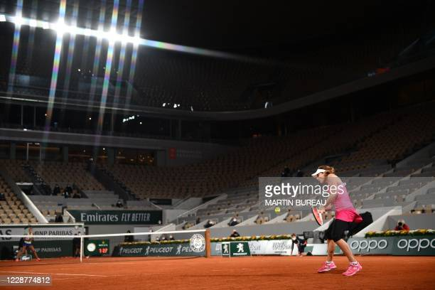 France's Alize Cornet returns the ball to France's Chloe Paquet during their women's singles first round tennis match on Day 2 of The Roland Garros...