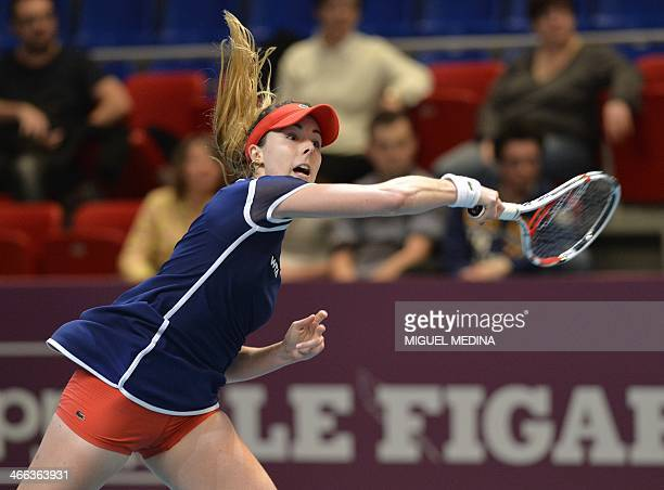 France's Alize Cornet returns the ball to Italy's Sara Errani during their semi final match at the WTA Paris Open tennis tournament in Paris on...