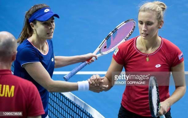 France's Alize Cornet shakes hands with Belgium's Elise Mertens after the FedCup World Group first round tennis match between Belgium and France in...