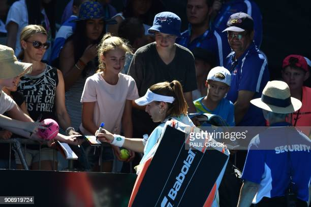 France's Alize Cornet signs autographs following her defeat against Belgium's Elise Mertens in their women's singles third round match on day five of...