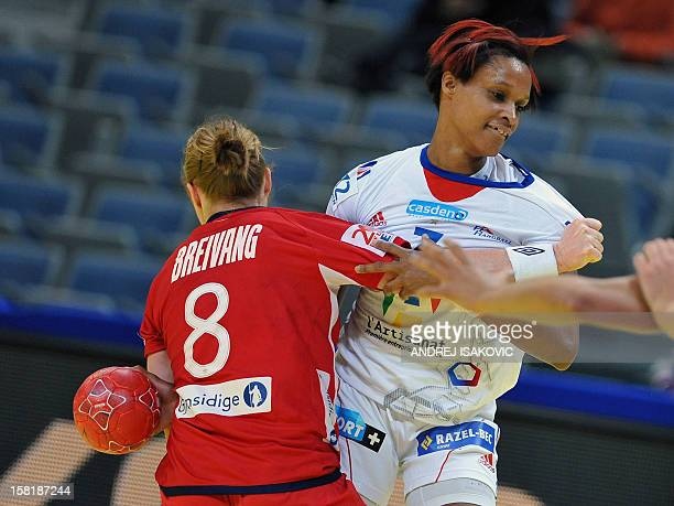 France's Allison Pineau vies with Norway's Karoline Dyhre Breivang during their Women's EHF Euro 2012 Handball Championship match Norway vs France on...