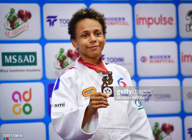France's Amandine Buchard poses with her bronze medal in the under 52kg women category of the 2018 Judo World Championships in Baku on September 21...