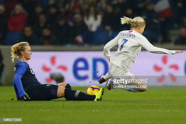 France's Amandine Henry vies with USA's Abby Dahlkemper during a women's friendly football match between France and USA at Oceane stadium in Le Havre...