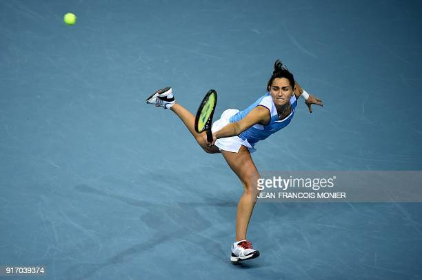 France's Amandine Hesse returns the ball during the double tennis match with teammate France's Kristina Mladenovic against Belgium's Elise Mertens...
