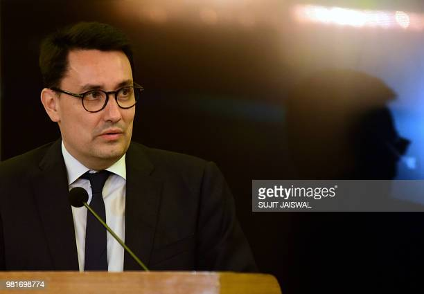 France's ambassador to India Alexandre Ziegler speaks at a ceremony to bestow Indian Bollywood actress Kalki Koechlin with the French distinction of...