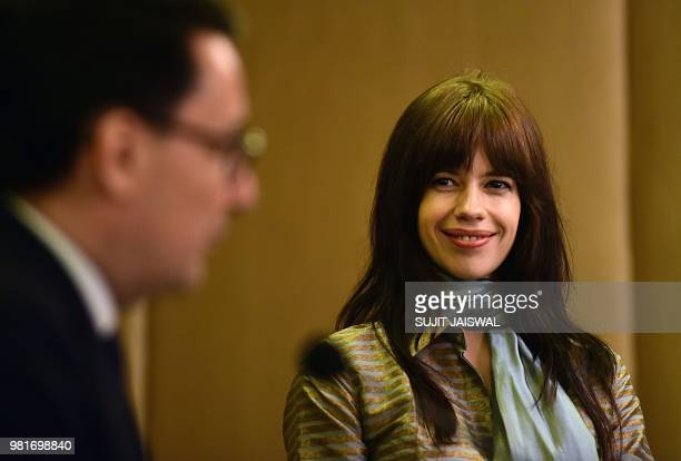 France's ambassador to India Alexandre Ziegler speaks next to Indian Bollywood actress Kalki Koechlin at a ceremony to bestow Koechlin with the...