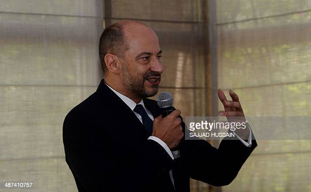 France's Ambassador to India Francois Richier gestures as he speaks during a press conference to announce the launch of 'The Kama Sutra' art...
