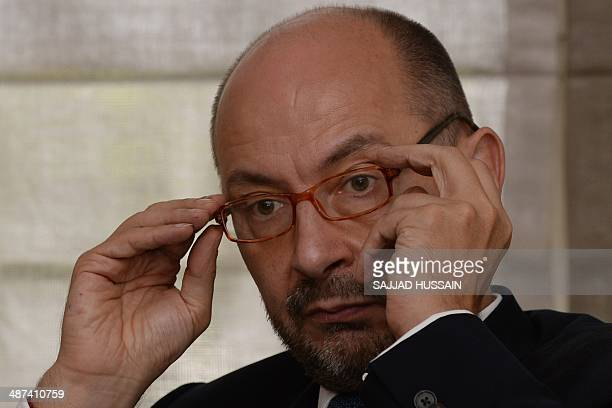 France's Ambassador to India Francois Richier looks on during a press conference to announce the launch of 'The Kama Sutra' art exhibition at his...