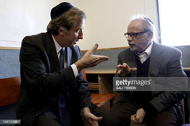France's ambassador to Israel Christophe Bigot pays his condolences in Jerusalem on March 22 2012 to Sammy Sandler the grandfather of two children...
