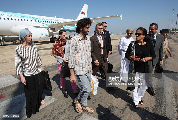 France's ambassador to Oman Malika Berak escorts three freed French hostages who were kidnapped by AlQaeda militants in Yemen more than five months...