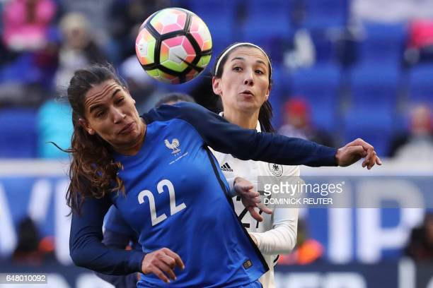 France's Amel Majri and Germany's Sara Doorsoun watch the ball as the France and Germany women's national teams play in the SheBelieves Cup in...
