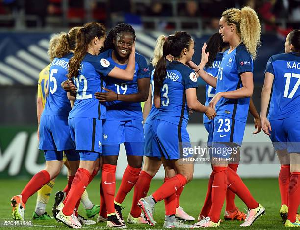France's Amel Majri celebrates with teammates after scoring during the 2017 UEFA Women's Euro qualifying football match between France and Ukraine at...