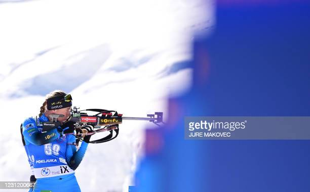 France's Anais Bescond competes at the shooting range in the Women's 15 km Individual event at the IBU Biathlon World Championships in Pokljuka,...