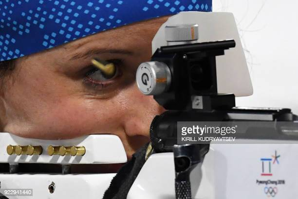France's Anais Chevalier competes at the shooting range before the women's 4x6km biathlon event during the Pyeongchang 2018 Winter Olympic Games on...