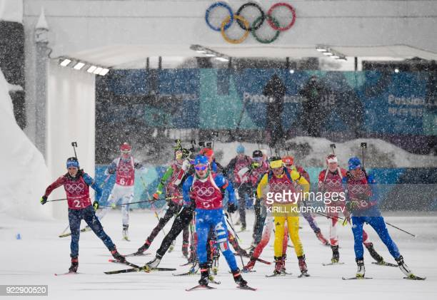 TOPSHOT France's Anais Chevalier Italy's Lisa Vittozzi Sweden's Linn Persson and USA's Susan Dunklee compete to the shooting range in the women's...
