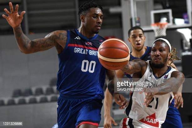 France's Andrew Albicy fights for the ball with Britain's Ovie Soko during the FIBA EuroBasket 2022 qualifier basketball match between France and...
