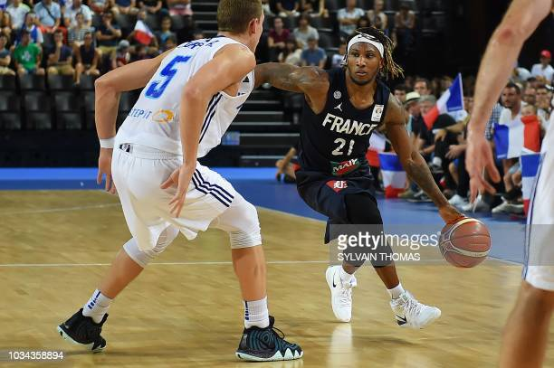 France's Andrew Albicy fights for the ball with Finland's Alex Murphy during the 2019 FIBA Basketball World Championship European qualifying group...