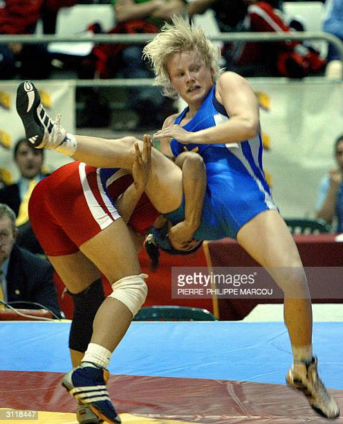 France's Anna Gomis wrestles against Sweden's Ida Theres Karlsson during their under 55 kg final bout for Athens Olympic Games classification in...