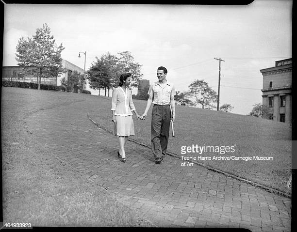 Frances Anne Walcott and Andrew H McCoy holding hands and walking on brick path Pittsburgh Pennsylvania June 1943