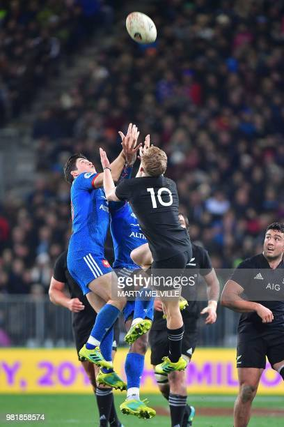 France's Anthony Belleau jumps for the ball with New Zealand's Damian McKenzie during the third and final rugby Test match between the New Zealand...