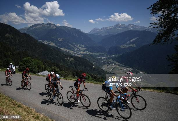 France's Anthony Perez Spain's Marc Soler and Italy's Damiano Caruso pedal in a breakaway group in the ascent of Bisanne during the eleventh stage of...