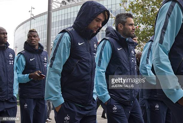 France's Antoine Griezmann walks with players and staff of the France football team escorted by British armed police around Wembley Stadium in west...