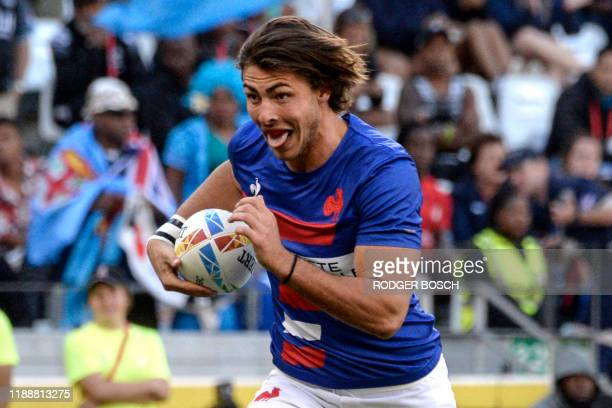 France's Antoine Zeghdar runs with the ball to score a try during the HSBC World Rugby Sevens Series men's bronze final rugby match between France...