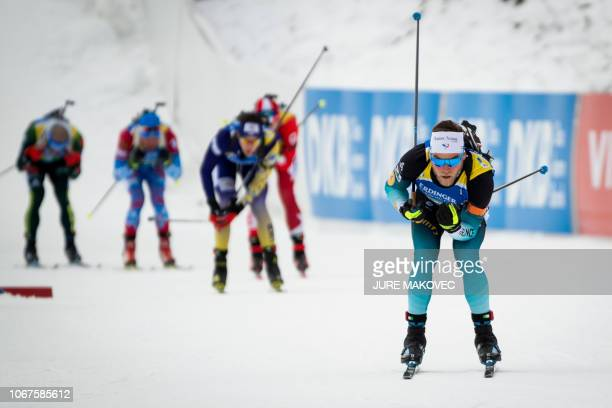 France's Antonin Guigonnat arrives at the shooting range during the Single Mixed Relay competition of the IBU Biathlon World Cup in Pokljuka on...
