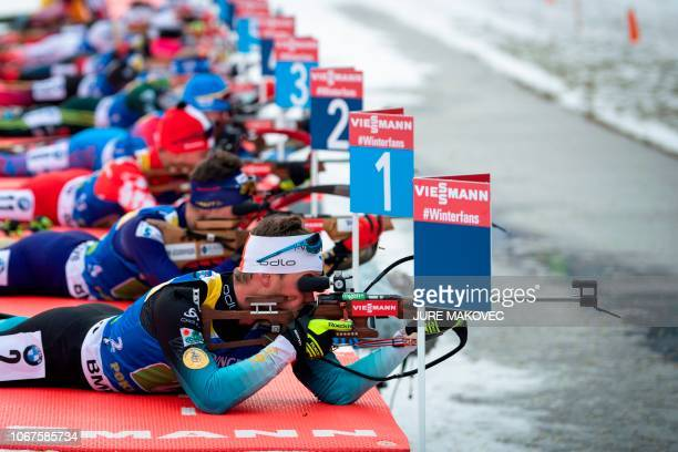 France's Antonin Guigonnat competes at the shooting range during the Single Mixed Relay competition of the IBU Biathlon World Cup in Pokljuka on...