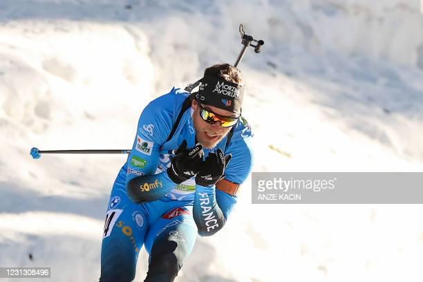 France's Antonin Guigonnat competes in the Men's 15 km Mass Start event at the IBU Biathlon World Championships in Pokljuka, Slovenia, on February...