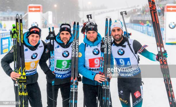 France's Antonin Guigonnat Simon Destieux Quentin Fillon Maillet and Martin Fourcade pose after placing second at the men's 4x75 km relay event of...
