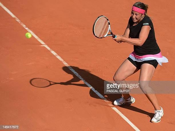 France's Aravane Rezai hits a return to Romania's Irina-Camelia Begu during their women's Singles 1st Round tennis match of the French Open tennis...