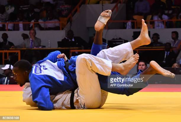 France's Ariano Rebouka Nell Honore fights against Canada's Marc Deschenes as they compete in the men's judo under 100kg at the palais des Sports in...
