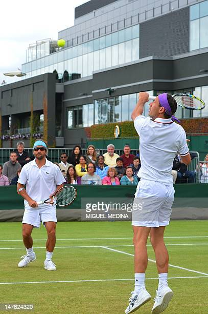 France's Arnaud Clement and France's Michael Llodra during their third round men's doubles match against US player Bob Bryan and US player Mike Bryan...