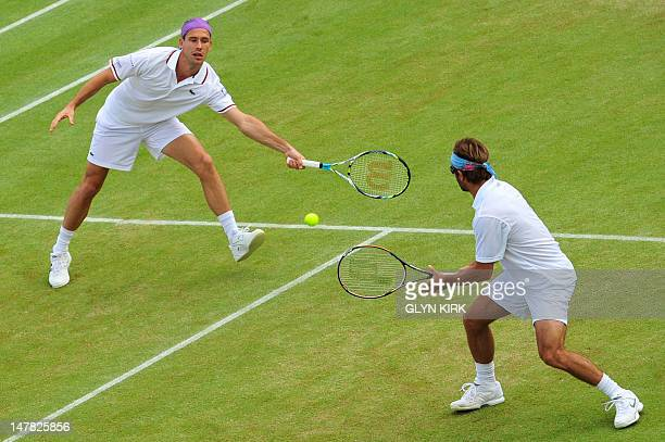 France's Arnaud Clement and France's Michael Llodra during their third round men's doubles defeat to US player Bob Bryan and US player Mike Bryan on...