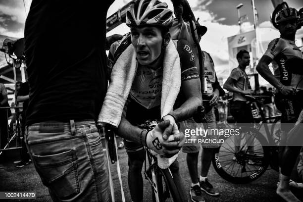 France's Arnaud Demare catches his breath after he crossed the finish line of the twelfth stage of the 105th edition of the Tour de France cycling...