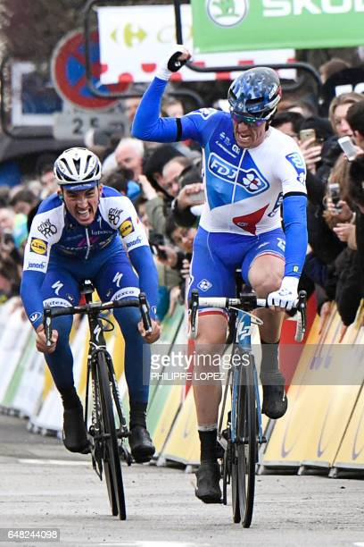 France's Arnaud Demare celebrates as he crosses the finish line ahead of France's Julian Alaphilippe at the end of the 1485km first stage of the 75th...