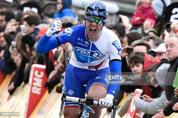France's Arnaud Demare celebrates as he crosses the finish line at the end of the 1485km first stage of the 75th edition of the ParisNice cycling...