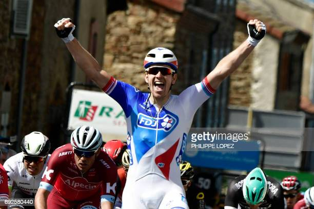 France's Arnaud Demare celebrates as he crosses the finish line at the end of the 171 km second stage of the 69th edition of the Criterium du...