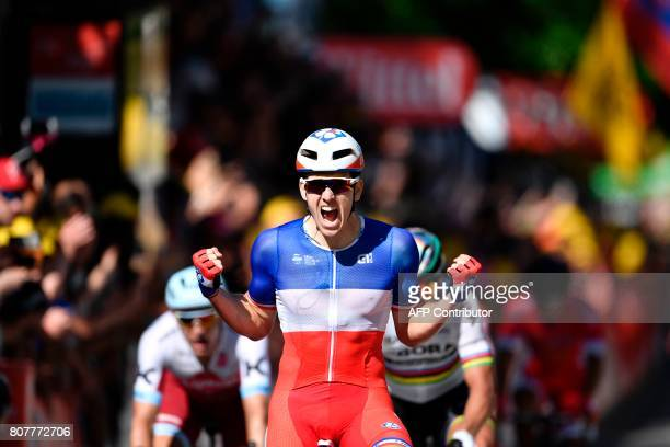 France's Arnaud Demare celebrates as he crosses the finish line at the end of the 2075 km fourth stage of the 104th edition of the Tour de France...