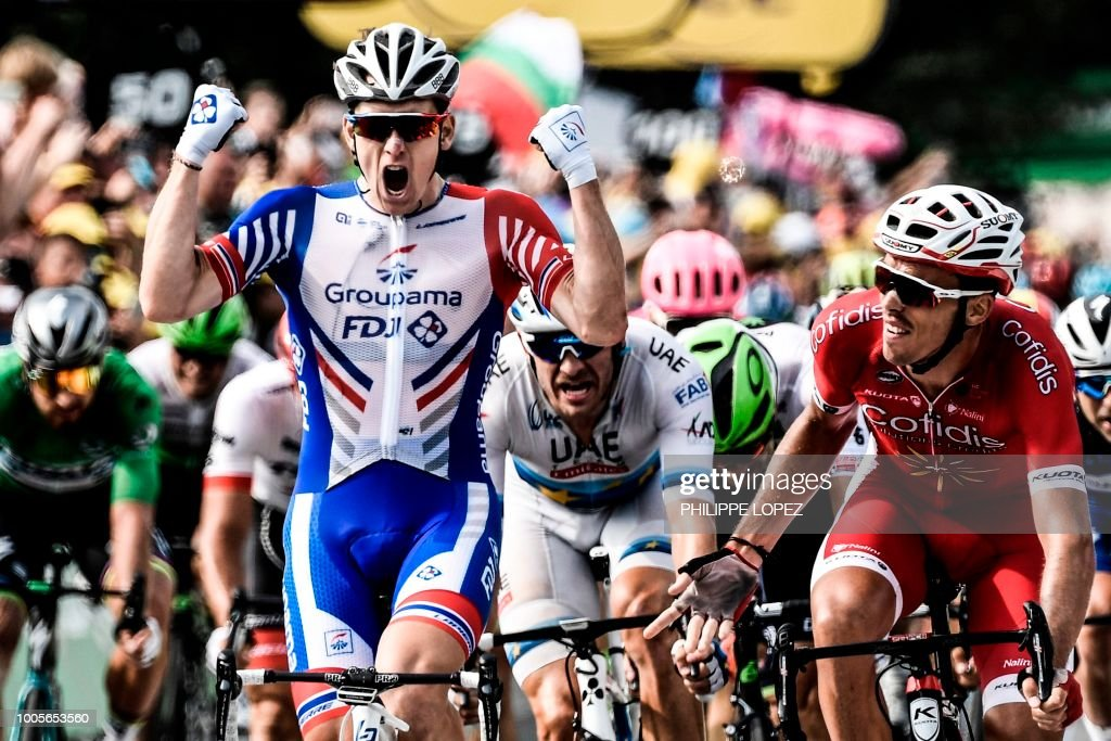 TOPSHOT - France's Arnaud Demare (L) celebrates as he crosses the finish line to win, ahead of France's Christophe Laporte (R) the 18th stage of the 105th edition of the Tour de France cycling race, on July 26, 2018 between Trie-sur-Baise and Pau, southwestern France. (Photo by Philippe LOPEZ / AFP) / ALTERNATIVE