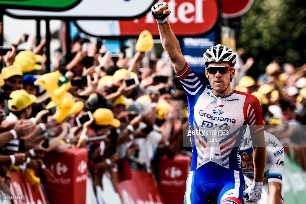 TOPSHOT - France's Arnaud Demare celebrates as he crosses the finish line to win the 18th stage of the 105th edition of the Tour de France cycling race, on July 26, 2018 between Trie-sur-Baise and Pau, southwestern France.