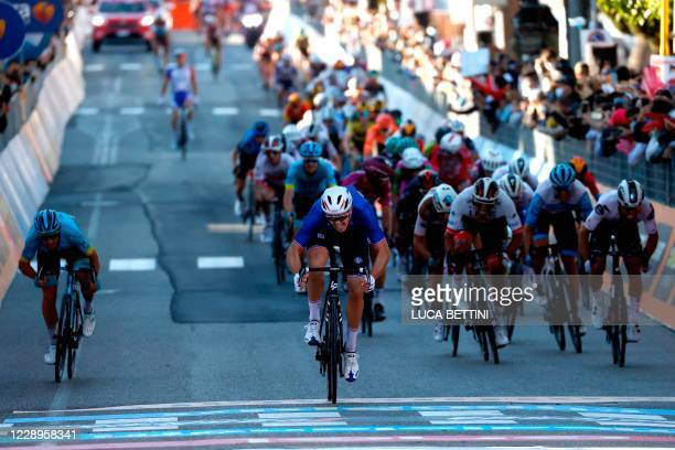 France's Arnaud Demare crosses the finish line for victory in the 6th stage of the Giro d'Italia 2020 cycling race, a 188-kilometer route between...